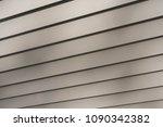 angled vinyl siding texture in... | Shutterstock . vector #1090342382