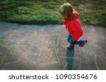 little girl playing hopscotch... | Shutterstock . vector #1090354676