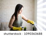 lovely woman cleaning window... | Shutterstock . vector #1090363688