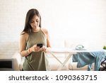 carefree woman using mobile... | Shutterstock . vector #1090363715