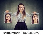 happy woman holding two... | Shutterstock . vector #1090368392