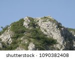 the stone hill on the banks of...   Shutterstock . vector #1090382408