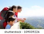 family on a trek day in the... | Shutterstock . vector #109039226