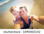 gay couple in love at the beach ... | Shutterstock . vector #1090402142