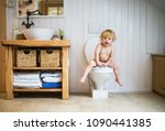 cute toddler boy sitting on the ... | Shutterstock . vector #1090441385