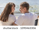 a happy young couple of... | Shutterstock . vector #1090463306