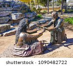 Small photo of FREDERICKSBURG, TEXAS - MARCH 7, 2018- Lasting Friendship Bronze Sculptures in Marktplatz Park by J Hester