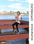 a slender blonde in a spring...   Shutterstock . vector #1090486202