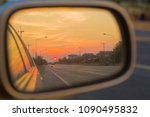 sunset background on car's side ... | Shutterstock . vector #1090495832