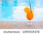 glass of tropical cocktail on... | Shutterstock . vector #1090535378