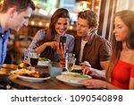 group of friends enjoying meal... | Shutterstock . vector #1090540898