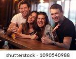 group of friends enjoying meal... | Shutterstock . vector #1090540988