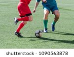 soccer action in which a...   Shutterstock . vector #1090563878