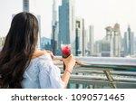 girl having a drink with dubai...   Shutterstock . vector #1090571465