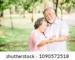 happy senior asian couple in... | Shutterstock . vector #1090572518