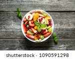 fresh fruit salad  top view in... | Shutterstock . vector #1090591298