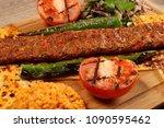 turkish adana kebab on the wood ... | Shutterstock . vector #1090595462
