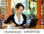 woman using laptop and writing... | Shutterstock . vector #109059728