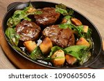 delicious steak meat with... | Shutterstock . vector #1090605056