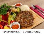 delicious beef steak meat on... | Shutterstock . vector #1090607282