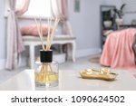 reed freshener on table in...   Shutterstock . vector #1090624502