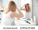 young woman with hair loss... | Shutterstock . vector #1090629488