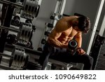 handsome young man training in... | Shutterstock . vector #1090649822