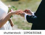the groom wears the bride a... | Shutterstock . vector #1090650368