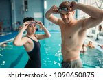 swimmers puts on a goggles in... | Shutterstock . vector #1090650875