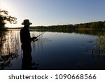 silhouette of fisherman... | Shutterstock . vector #1090668566