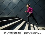athletic woman running up... | Shutterstock . vector #1090680422
