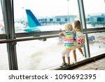 Kids At Airport. Children Look...