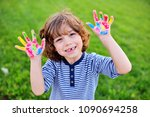 cheerful child boy with curly... | Shutterstock . vector #1090694258