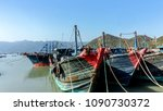 fishing boats moored in the... | Shutterstock . vector #1090730372
