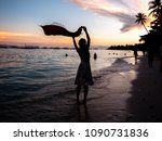 woman holding a scarf on the...   Shutterstock . vector #1090731836