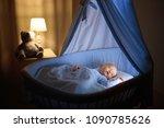 adorable baby drinking milk in...   Shutterstock . vector #1090785626