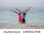 two young girls doing gymnastic ... | Shutterstock . vector #1090811948