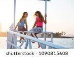 two teenagers girls sittihg on... | Shutterstock . vector #1090815608