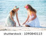 two teenagers girls sitting on... | Shutterstock . vector #1090840115