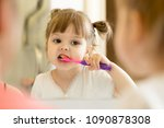 cute child girl looking at... | Shutterstock . vector #1090878308