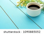 a mug of hot black coffee and a ... | Shutterstock . vector #1090885052