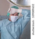 Surgeon is very tired and happy saving live - stock photo