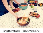 people preparing food for party | Shutterstock . vector #1090901372