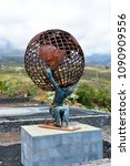 Small photo of GUIMAR, TENERIFE, SPAIN - APRIL 06: Sculpture with Titan Atlas carry the world on his shoulders, historic figure from Greek mythology, on April 06, 2018 in Guimar, Spain
