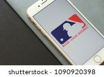 Small photo of MINSK, BELARUS – May 12, 2018: White Apple iPhone 7. The official logo of the Major League Baseball, MLB logo.