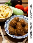 a bowl of beef meatballs with sauce - stock photo