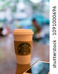 Small photo of Sg Wang, Kuala Lumpur, 3rd May 2018. A Starbucks coffee cup in a Starbucks shop with blurred background