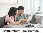 couple use laptop computer... | Shutterstock . vector #1091005982