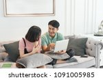 couple use laptop computer... | Shutterstock . vector #1091005985