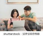couple use laptop computer... | Shutterstock . vector #1091005988